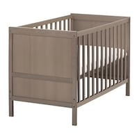 Gray-brown wooden crib with changing table Huntington Beach, 92647