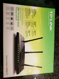 black and green TP-Link wireless router box
