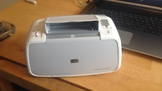 white and gray HP printer