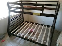 Brown wooden bunk bed full size bottom twin on top North Las Vegas, 89031