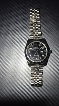 round black chronograph watch with silver link bracelet Terrebonne