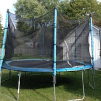 round black and blue trampoline with enclosure Houston, 77065