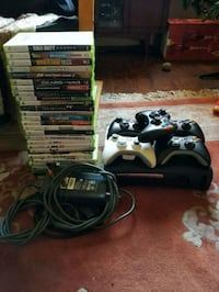 black Xbox 360 with controllers and game cases Surrey, V3T 1G4