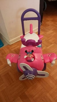 pink Minnie Mouse plane rid-on toy