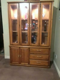 brown wooden framed glass display cabinet Medford