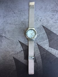 Round silver analog watch with white leather strap Vancouver, V6B