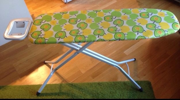 green yellow and white ironing board