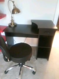 black wooden desk with black rolling chair Manassas, 20111
