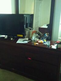 black flat screen TV with black wooden TV stand Baltimore, 21223