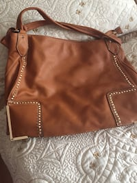 brown leather crossbody bag with tassel Montréal, H1H 4V2