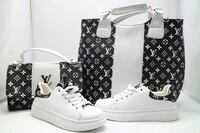 pair of white Louis Vuitton sneakers and two black-and-white Louis Vuitton handbags Toronto, M6N 1A7