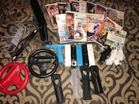 black Nintendo Wii console with controllers and game cases Highland, 92346