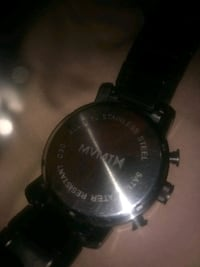round black chronograph watch with black leather strap London, N6J