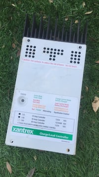 Xantrex solar charge controller/ load controller. Works perfect. I've been using it on a small system. Escondido, 92026