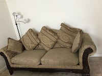 Brown and beige floral fabric loveseat 21 km