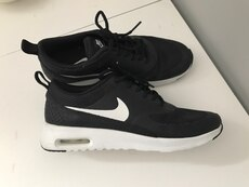 pair of black-and-white Nike low top sneakers
