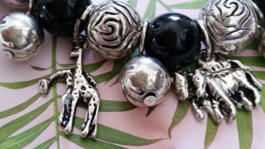 Silver plate charms with animals  bracelet  ae2aa54e-fdc9-4b68-83f7-daaf9edd1d39
