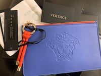 Double sided Versace purse.