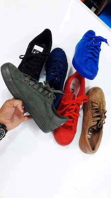 six unpaired assorted sneakers