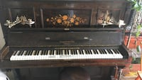 brown, white, and black upright piano 40 km