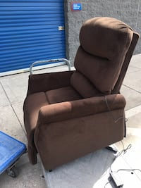 Brown remote stand up recliner Baltimore, 21229