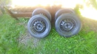 black bullet hole vehicle wheel and tire set Waterloo, N2K 1S5