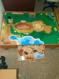 Imaginarium kid's train table with tracks and trains