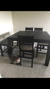Dark brown table that extends. Includes 4 chairs and a bench Ashburn, 20147