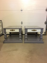 two rectangular white-and-gray coffee tables