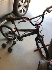 18 inch boys bike with training wheels. Barely used.  Retails for 79.