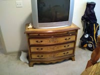 gray CRT TV with brown wooden TV stand