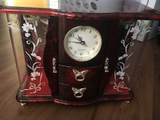 Red  jewelry box with clock