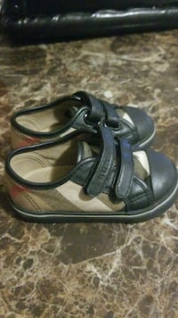 baby's pair of black-and-gray strap shoes