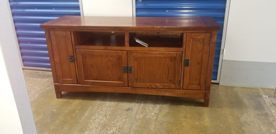 Brown wooden tv stand with cabinet... 18b0bae9-07fb-4586-8450-8d7e80f5f2df