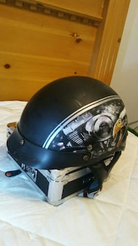 black and white motorcycle half-face helmet
