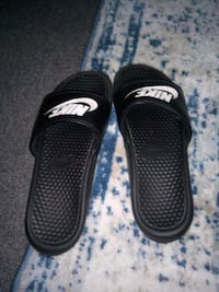 pair of black Nike slide sandals Hyattsville, 20783