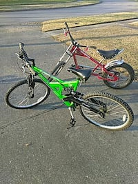 two green and red chopper and rigid bicycle