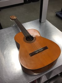 brown and black acoustic guitar Chicago, 60647