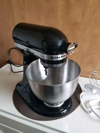 stainless steel and black KitchenAid stand mixer
