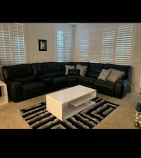 Black leather sectional with ISB charger