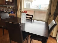 Solid wood dinning table from Brick and chairs  3126 km