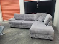 gray suede sectional sofa with throw pillows Chesapeake