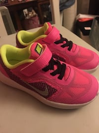Pair of pink nike running shoes