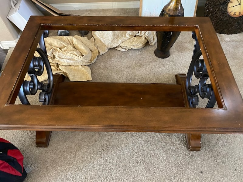 Everything must go 2 coffee tables a kitchen table couch and pictures 62ef2227-62ae-416c-aba0-97332cd417c2