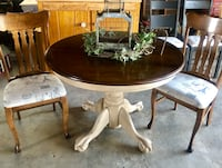 Newly refinished round pedestal ball in claw table with two chairs upholstered in a Paris theme. Bakersfield, 93306