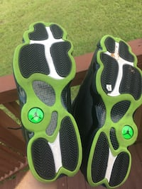 pair of black-and-green Nike basketball shoes Jacksonville, 32210