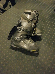 pair of gray-and-black riding boots