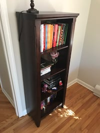 Two brown bookcases with 4 shelves