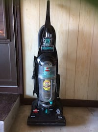 black and blue Bissell upright vacuum cleaner Lowellville, 44436