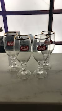 four gold rim Stella Artois short-stem wine glasses